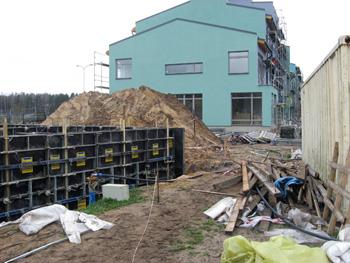 Восстановление уровня грунтовых вод под существующим зданием